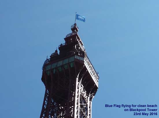 Blackpool Tower flying the Blue Flag for clean beach in May 2016