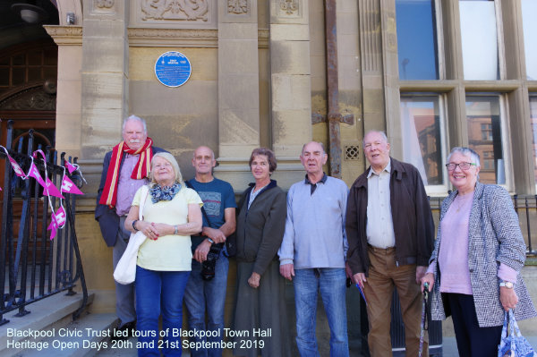 Visitors standing under the Blue Plaque of Lucy Morton on Blackpool Heritage Open Day 21st September 2019